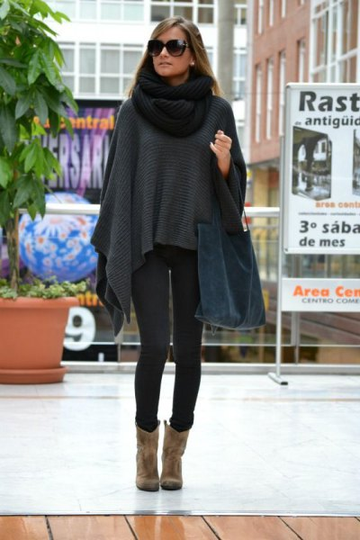 grey poncho sweater with black knit scarf