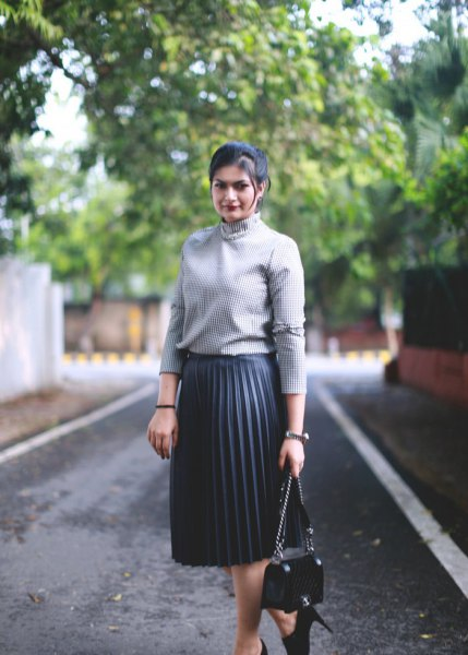 grey ribbed mock neck sweater with black pleated midi skirt