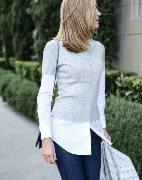 grey scalloped tee over white button up shirt