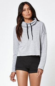 grey slightly cropped hoodie with black high rise mini shorts