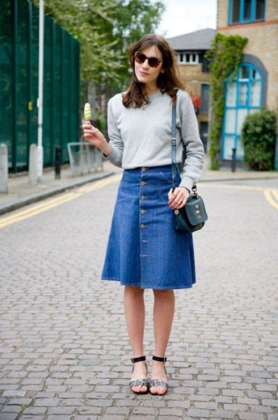 grey sweatshirt with blue flared denim knee length skirt