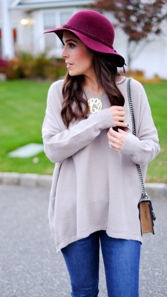 grey tunic sweater with black floppy hat