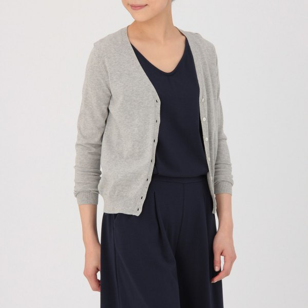 grey v neck cardigan with black sweater and wide leg pants