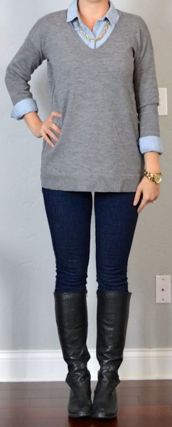 grey v neck sweater with black leather knee high boots