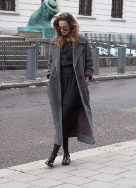 grey wool maxi coat with button up shirt and pleated mini skirt