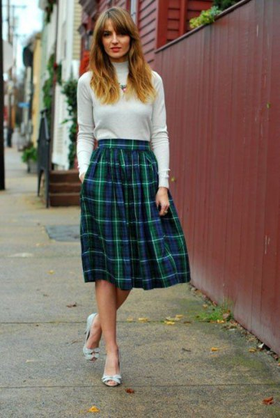ivory mock neck sweater with midi flared plaid skirt