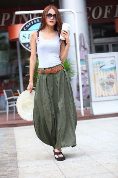 light grey vest top with green long khaki skirt