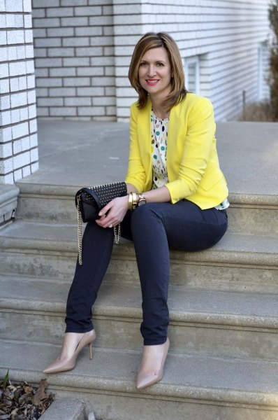 multi colored polka dot blouse and blue jeans