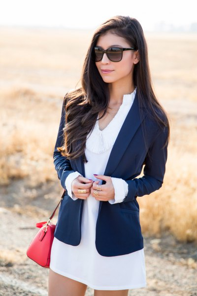 navy blazer with white mini dress