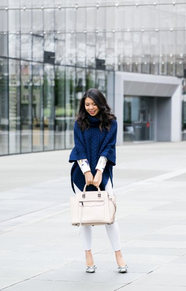 navy cable knit poncho sweater with white skinny ankle jeans