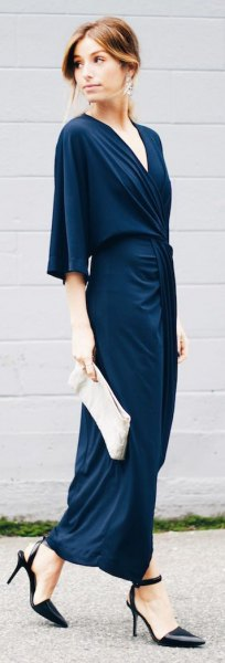 navy half sleeve maxi wrap dress with white clutch bag