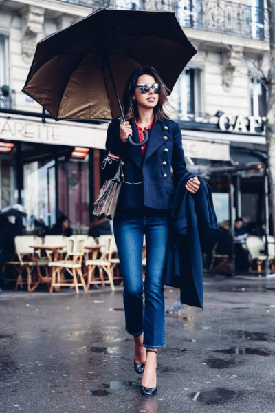 navy military blazer with cuffed blue jeans