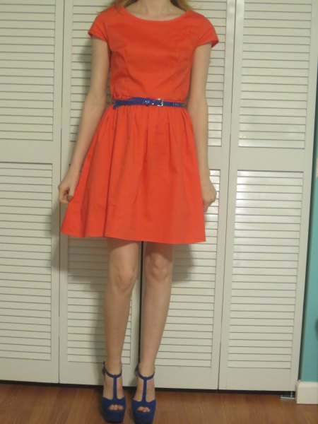 orange cap sleeve mini skater dress with blue narrow leather belt