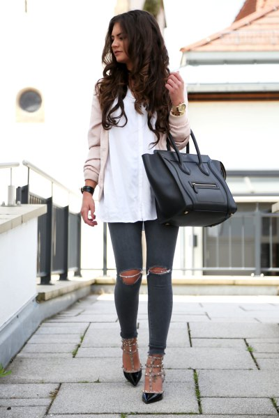 pale pink bomber jacket with white shirt and black kitten heels