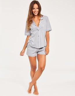 pale pink button up pajama shirt with matching mini shorts