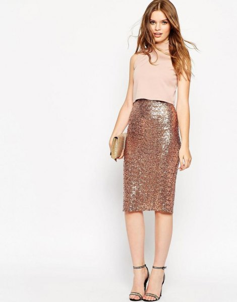 pale pink sleeveless top with rose gold high waisted midi skirt
