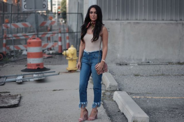 pale pink vest top with blue fringe ankle jeans