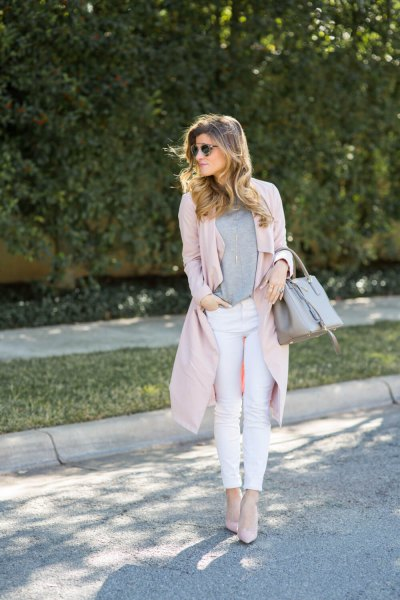 pink duster sweater with white skinny jeans