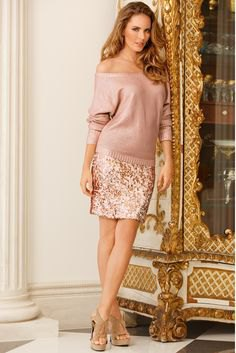 pink off the shoulder knit sweater with rose gold skirt