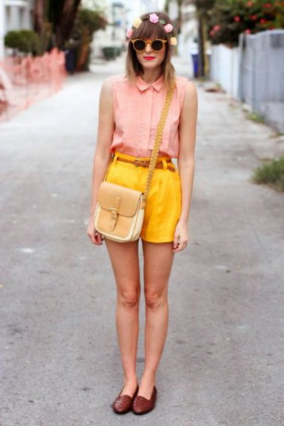 pink sleeveless button up shirt with lemon yellow high waisted shorts