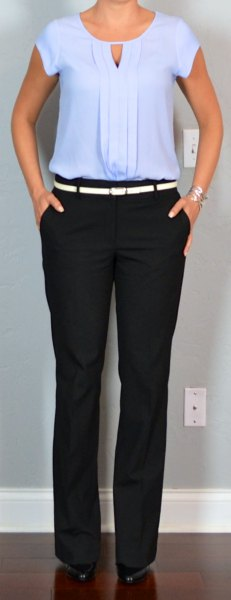 pleated blouse with black chinos and white belt