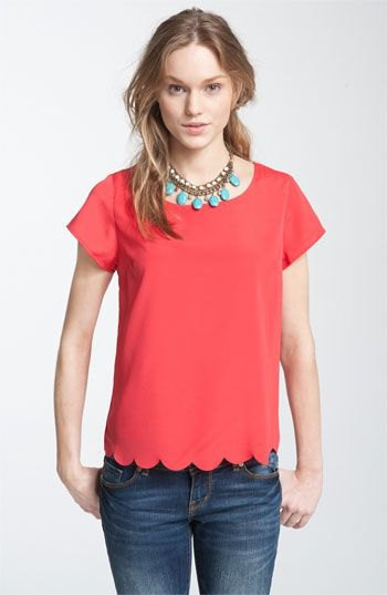 red scalloped short sleeve shirt with blue skinny jeans