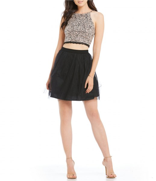 silver cropped hater top with black mini skater skirt