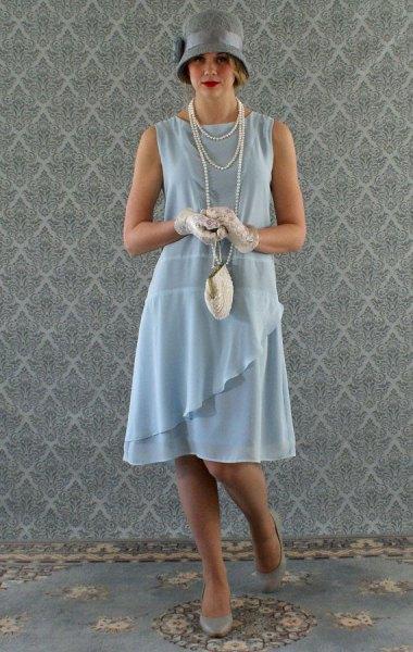 teal ruffle gatsby style midi dress with grey felt hat