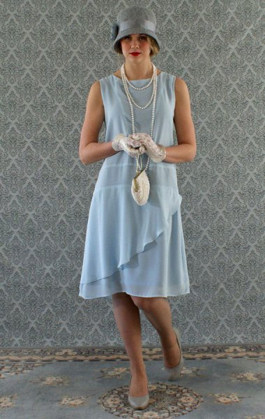 teal ruffle gatsby style midi dress with grey felt hat