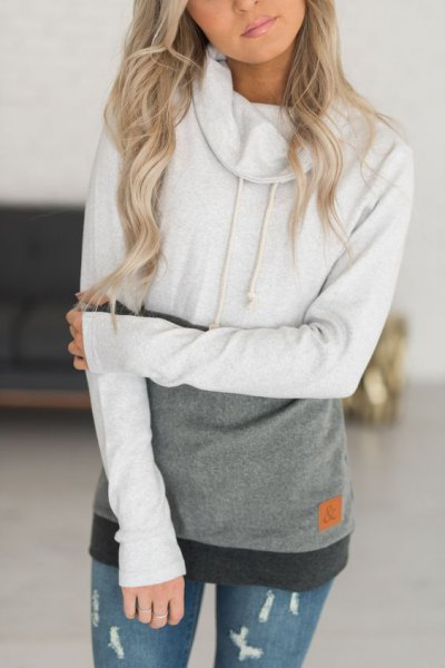 white and grey color block hoodie with ripped skinny jeans