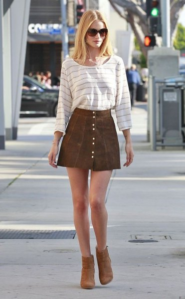 white and grey striped long sleeve tee with brown suede button down mini skirt
