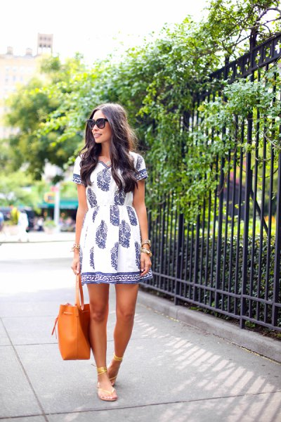 white and navy printed tunic dress with gold sandals