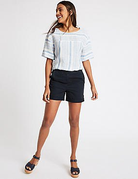 white and pale blue tee with navy shorts