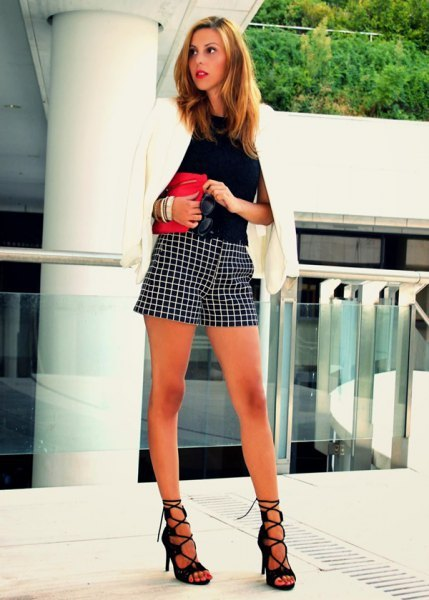 white blazer with black blouse and checkered shorts