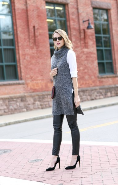 white blouse with grey turtleneck tunic sweater and leather leggings