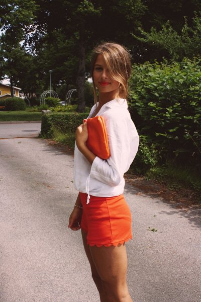 white blouse with orange scalloped hem shorts