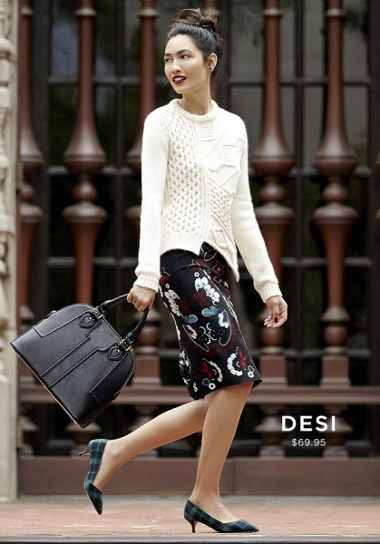 white cable knit sweater and black floral knee length skirt