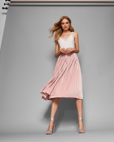 white camisole with pale pink pleated midi skirt