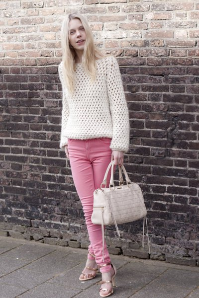 white crochet sweater with pink skinny jeans
