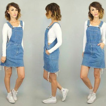 white cropped form fitting sweater with blue denim suspender dress