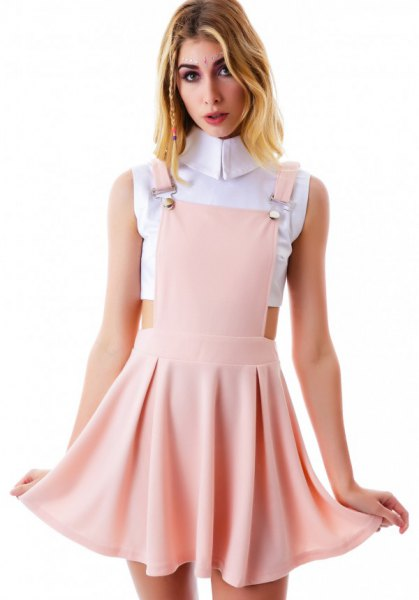 white cropped sleeveless blouse with blush pink mini skater suspender dress