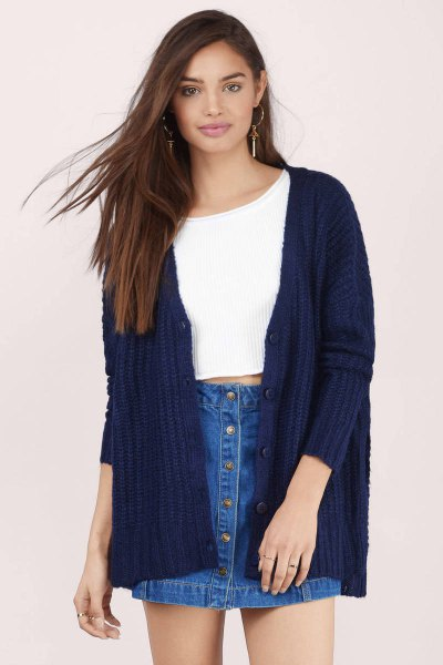white cropped sweater with ribbed navy cardigan and denim skirt