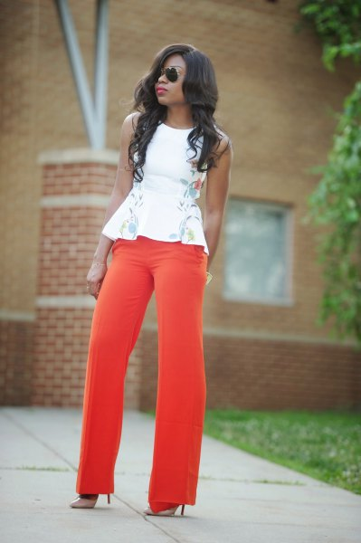 white floral embroidered sleeveless peplum blouse with red wide leg pants