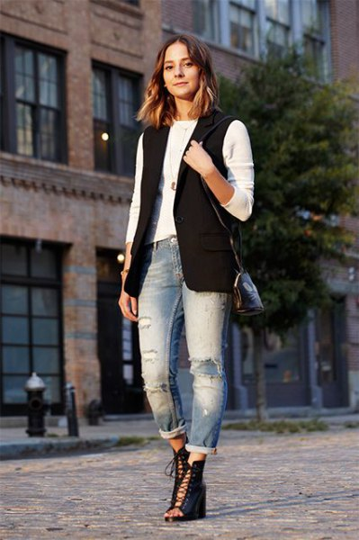 white form fitting long sleeve tee with black sleeveless jacket