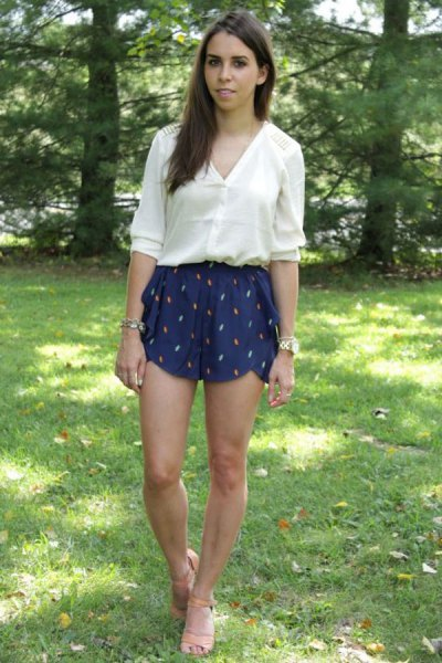 white half sleeve shirt with navy flowy silk shorts