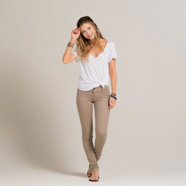 white knotted t shirt with crepe skinny khaki jeans