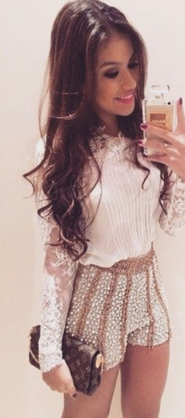 white lace long sleeve blouse with pink sequin mini shorts
