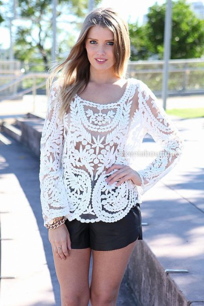 white lace top with black mini leather shorts