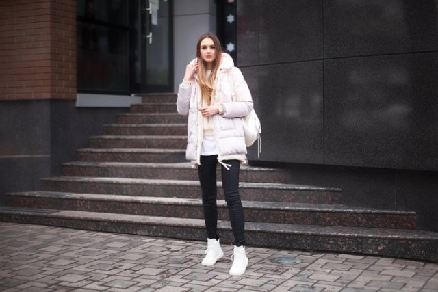 white long bubble coat with black skinny jeans and high top sneakers