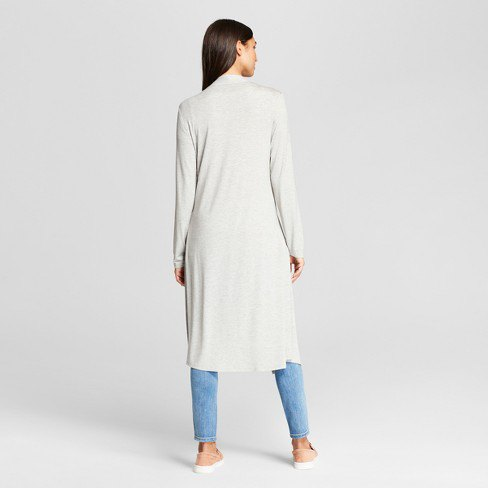 white long midi shawl collar sweater with light blue jeans